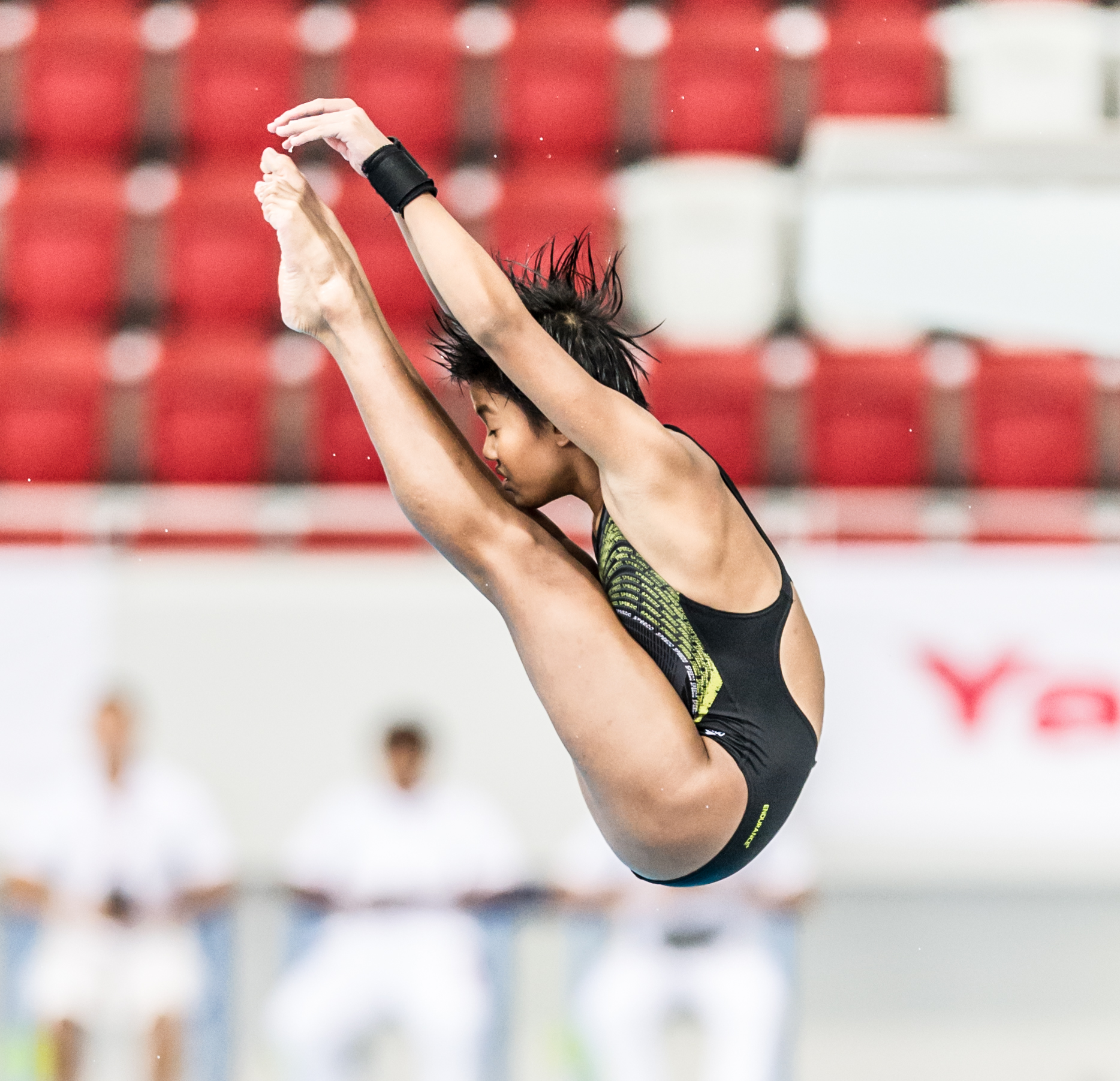 A diver rotates in the air during the Singapore National Diving Championships at the OCBC Aquatic Centre.