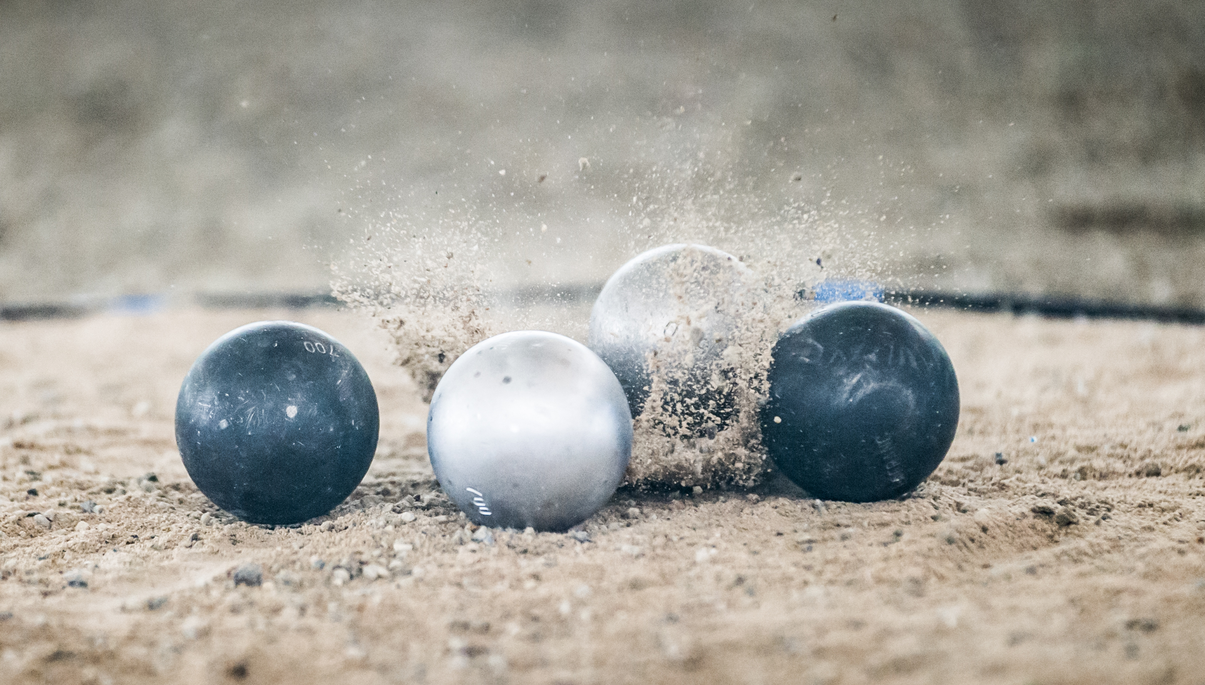 Petanque balls collide during the ASEAN University Games at the Toa Payoh Sports Complex.