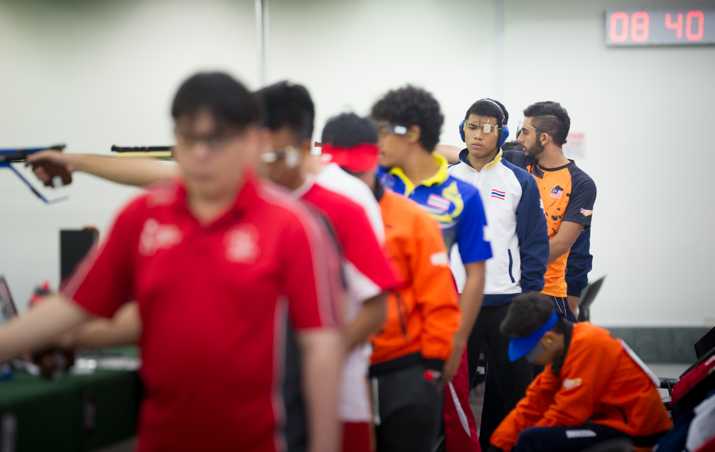 A Thai shooter recomposes himself during the shooting competition of the ASEAN University Games at Yishun SAFRA.