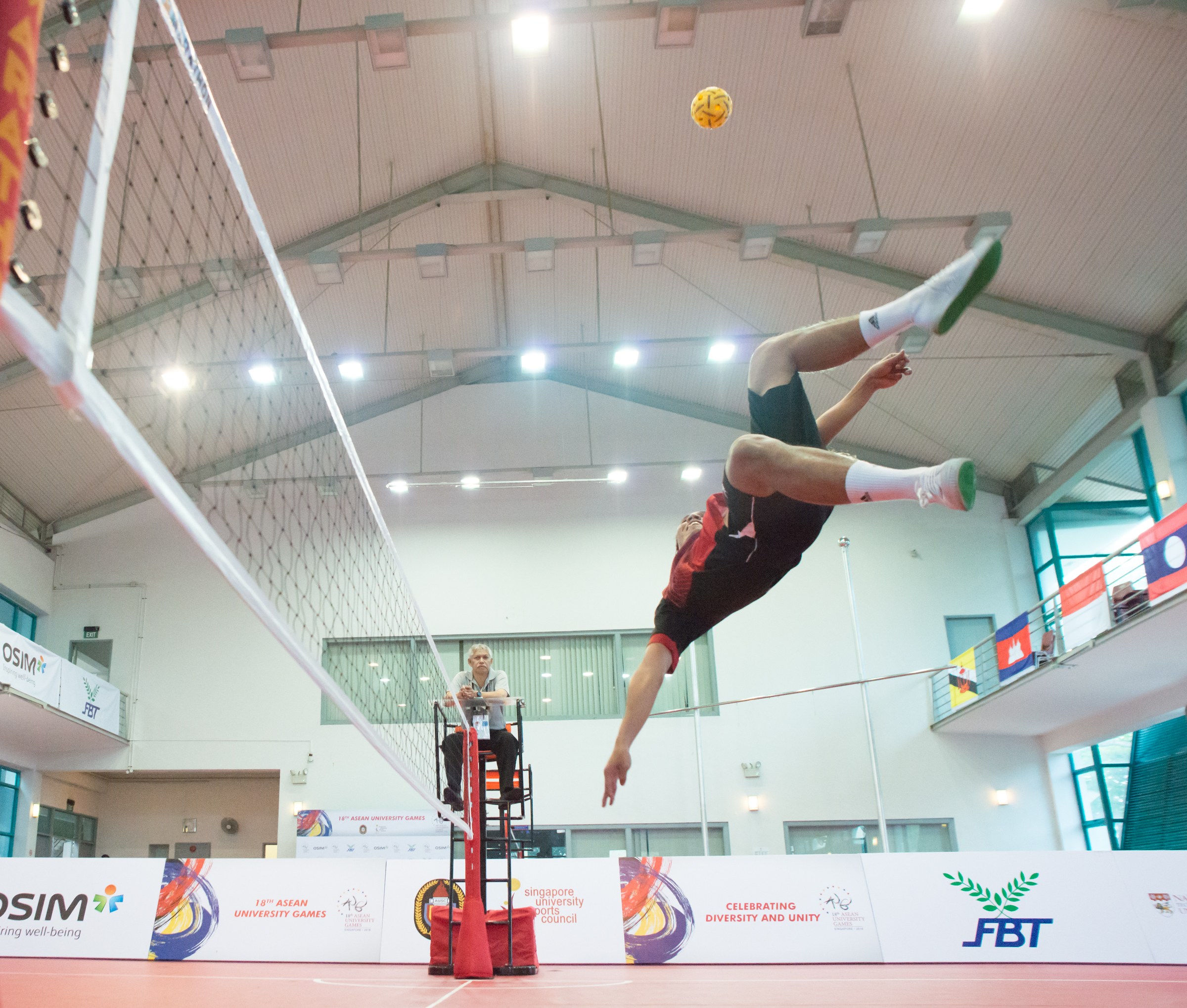 A Malaysian player prepares to kick the ball during the sepak takraw competition of the ASEAN University Games at the Bedok Sports Hall.