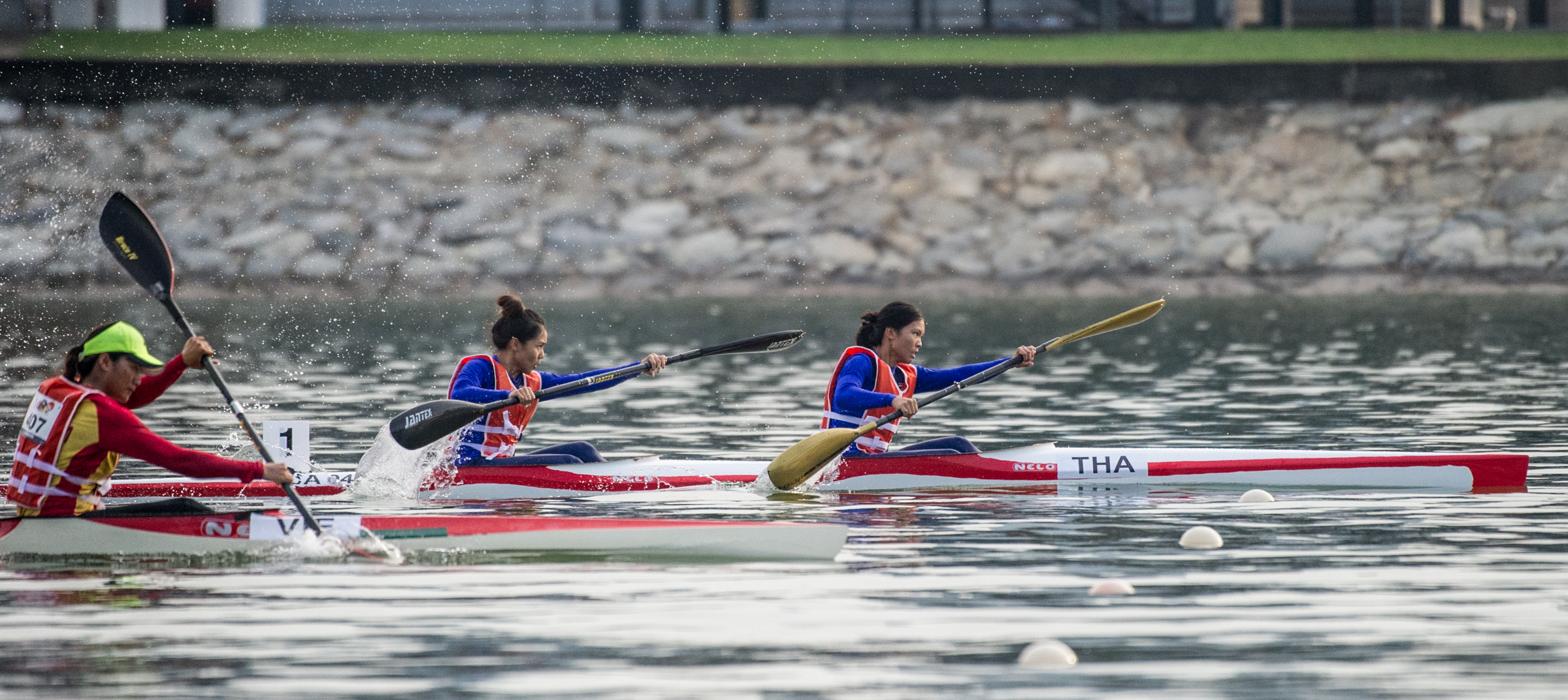 A Thai pair take an early lead in the Canoeing competition of the ASEAN University Games at the Marina Channel.