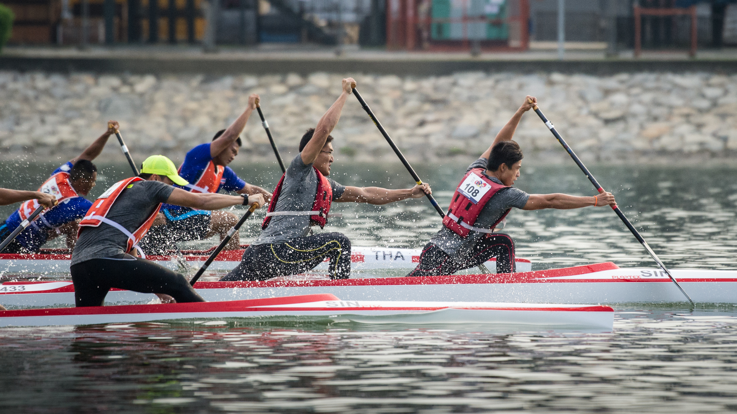A Singaporean pair take an early lead in the Canoeing competition of the ASEAN University Games at the Marina Channel.