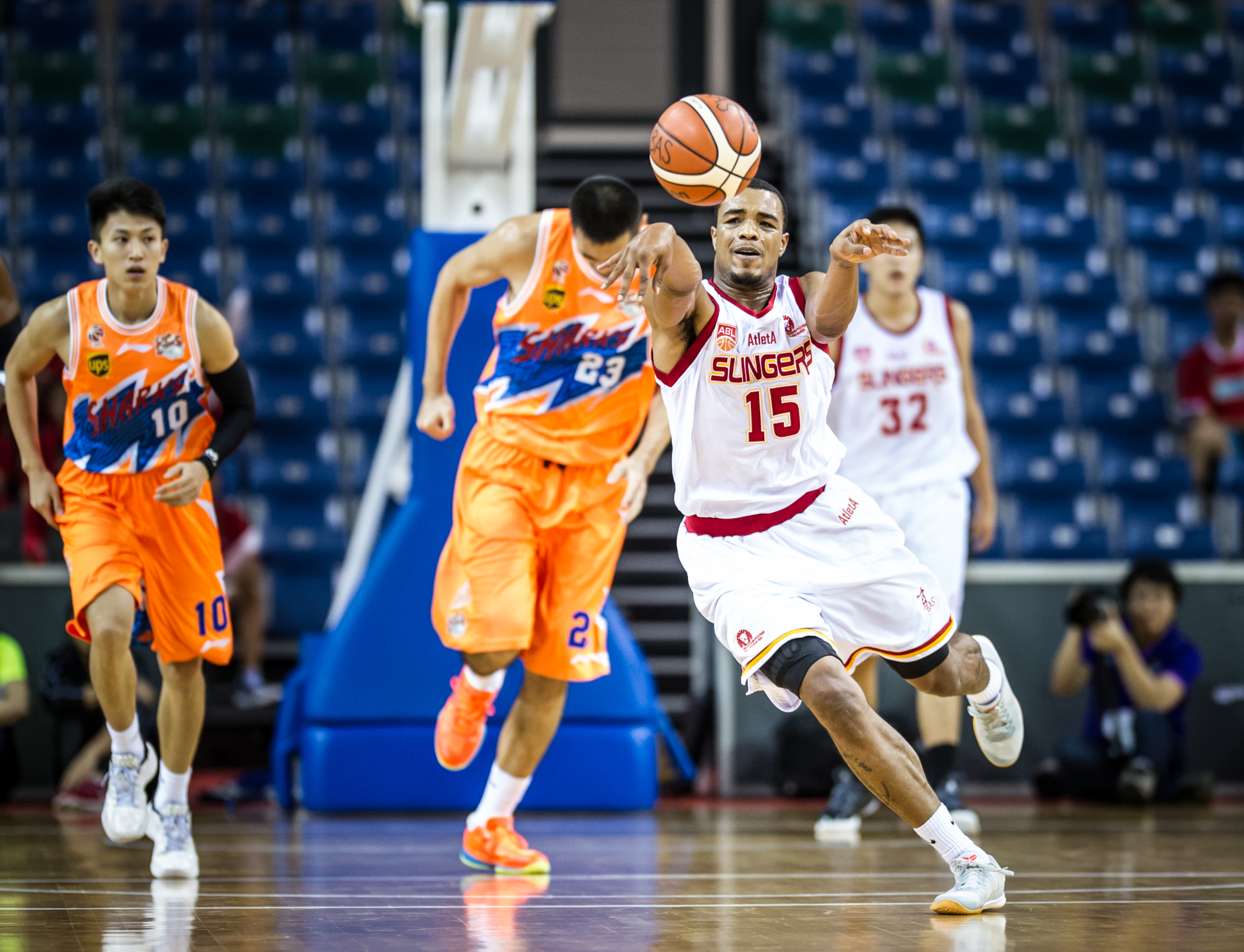 A Singapore Basketball player passes the ball during the Merlion Cup basketball competition at the OCBC Arena.