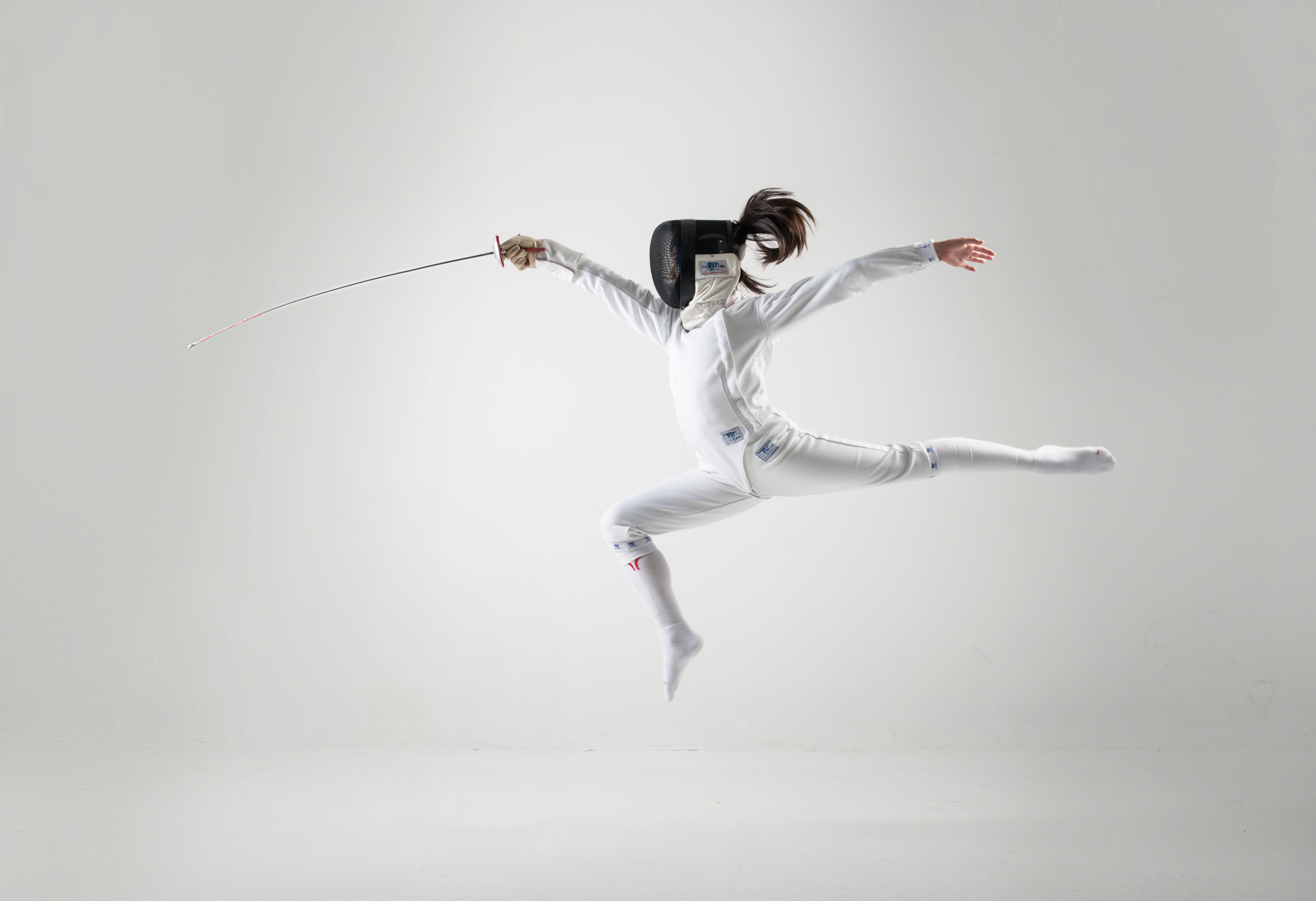 A fencer lunges in the Studio.