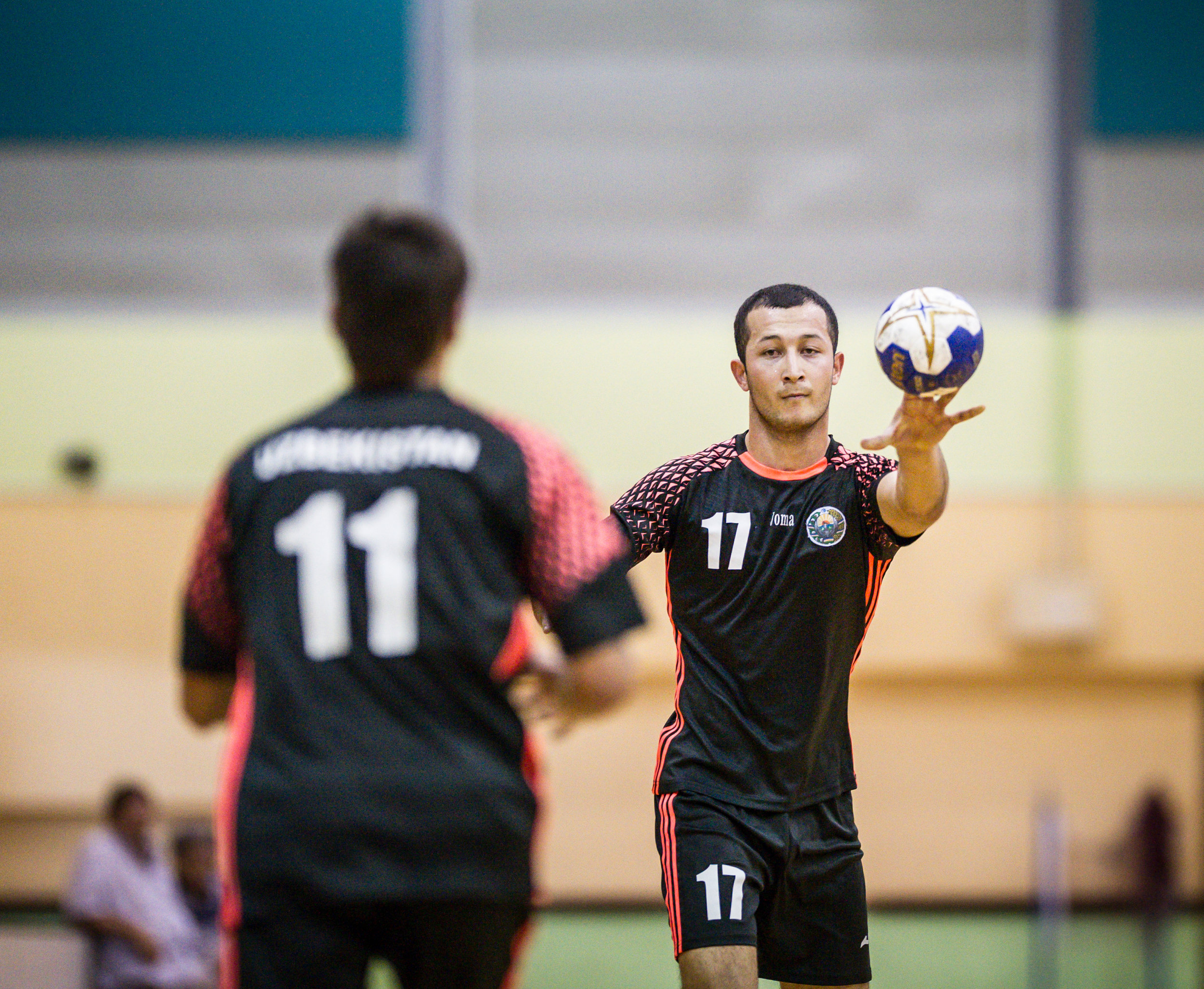 An Uzbek player passes the ball to a team mate during an International hand ball match at the Sengkang Sports Complex.
