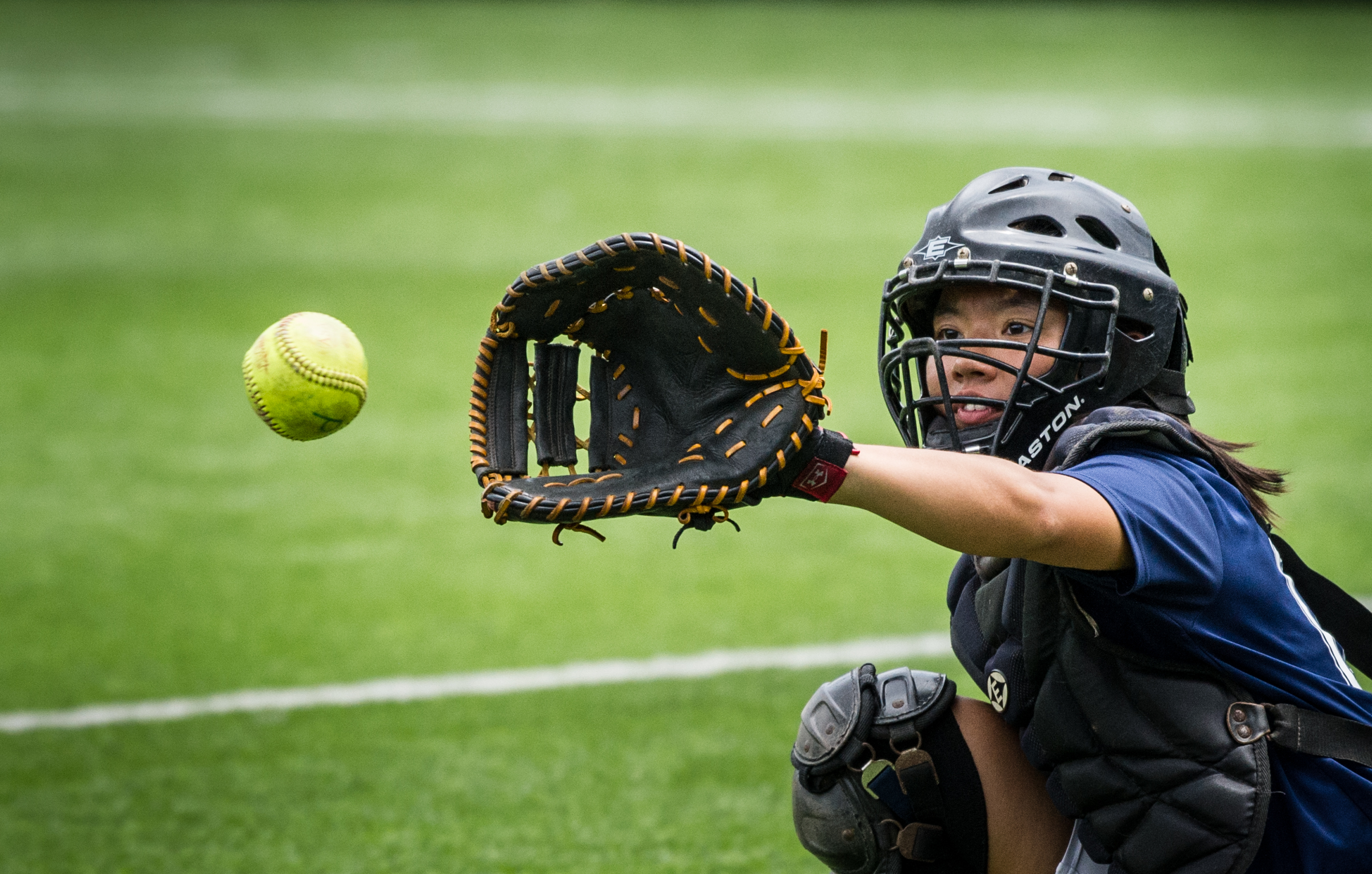 A Singaporean player prepares to catch the ball during the ORA Gryphon Cup slow pitch tournament at Raffles Institution.
