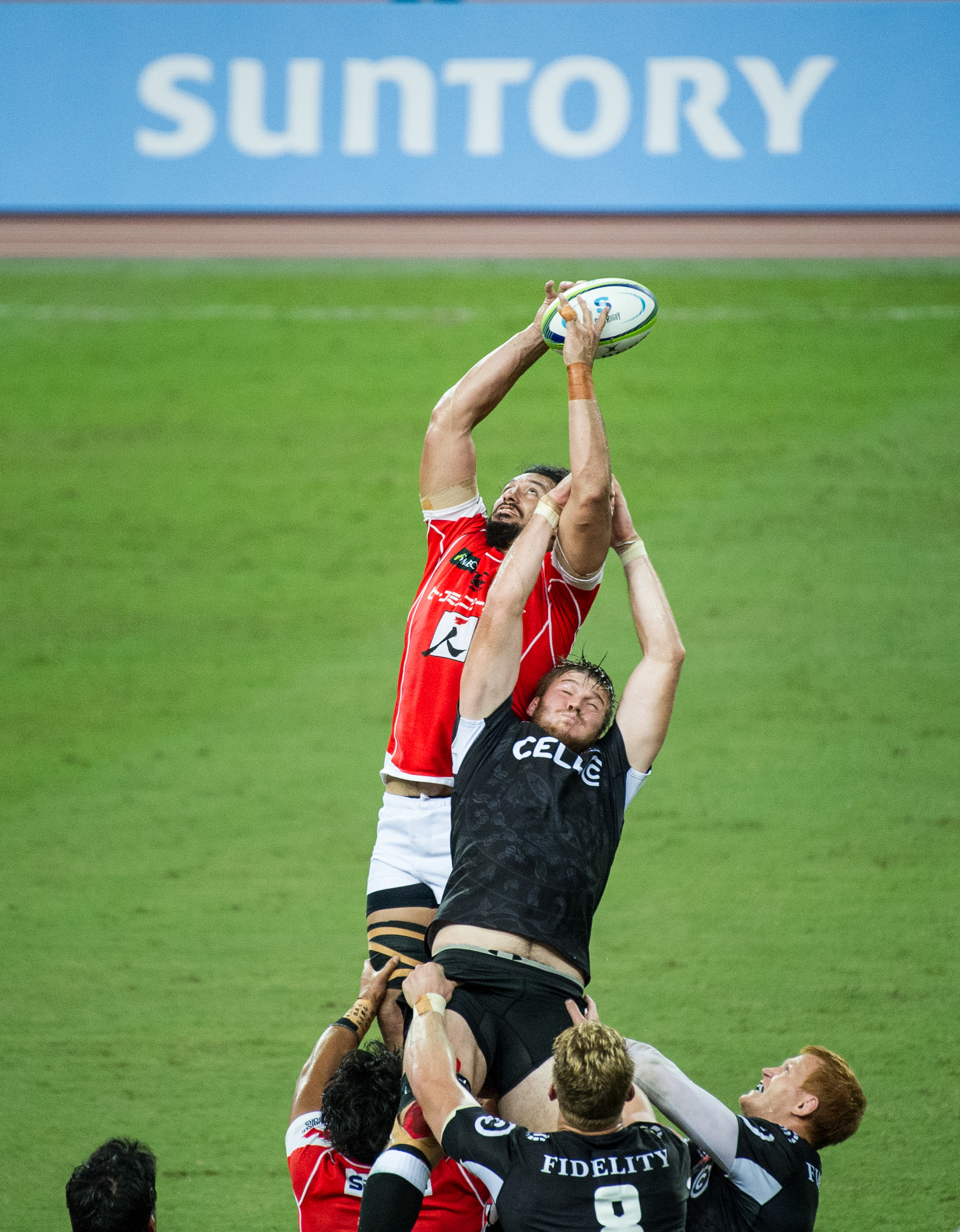 A South African and Japanese player at a line out during a Super Rugby match at the Singapore Sports Hub.