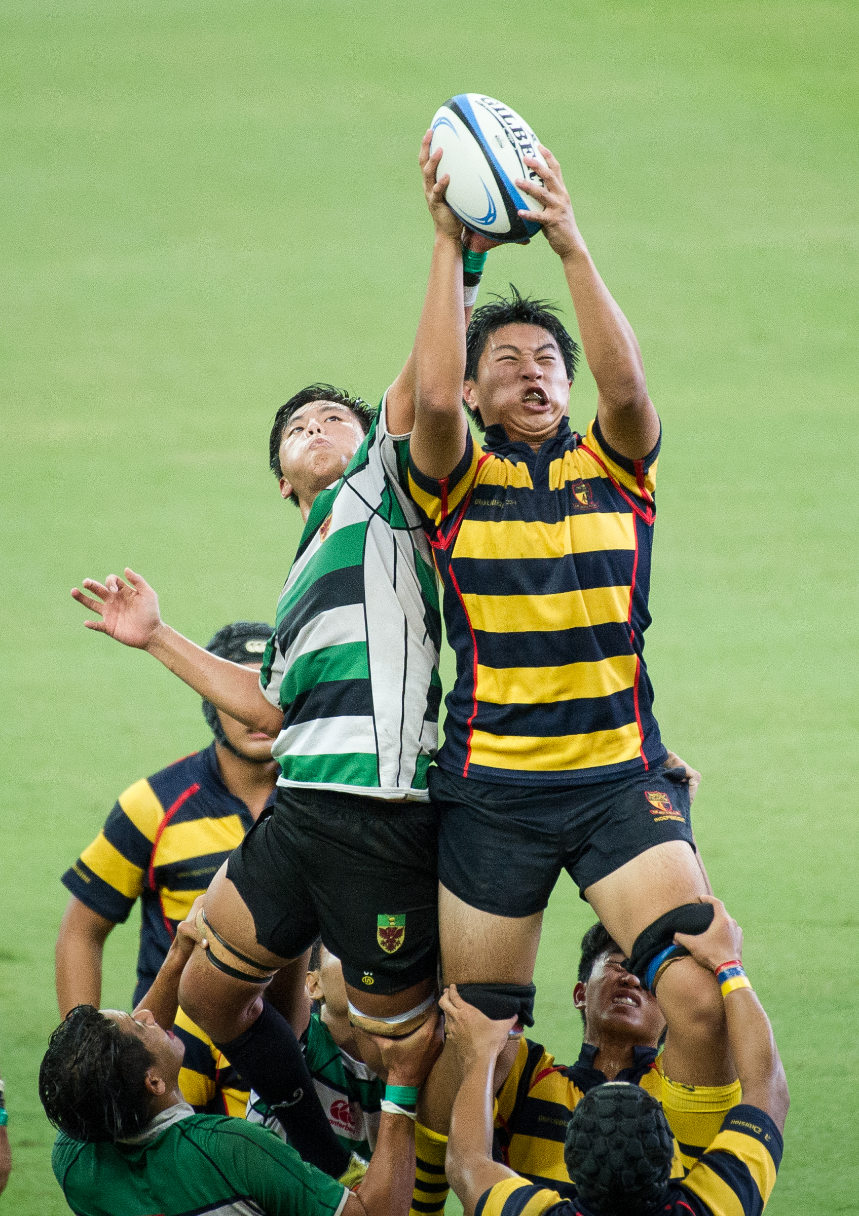 Schoolboys in a line out during a schools rugby match at the Singapore Sports Hub.