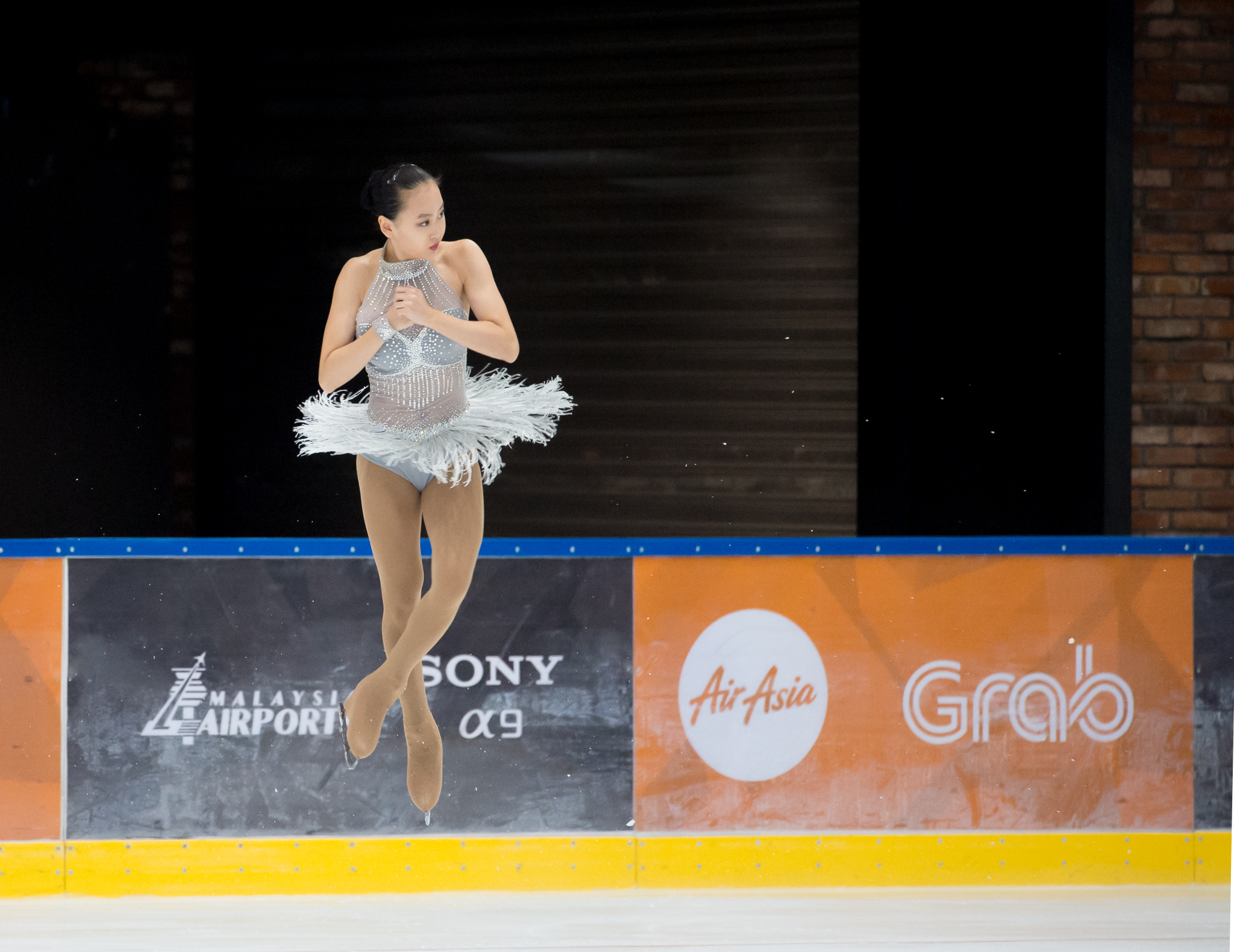 A Singaporean figure skater in action during the SEA Games at the Empire City Skating Rink.