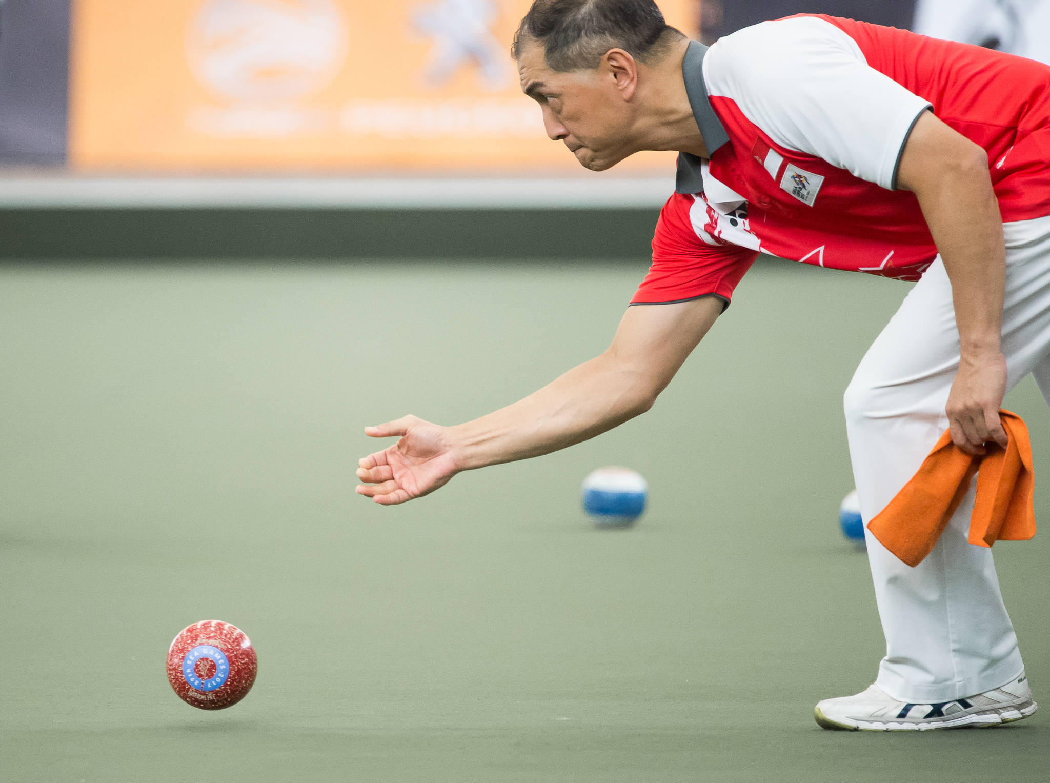 A Singaporean Lawn Bowler in action during the SEA Games at the National Lawn Bowls Centre.