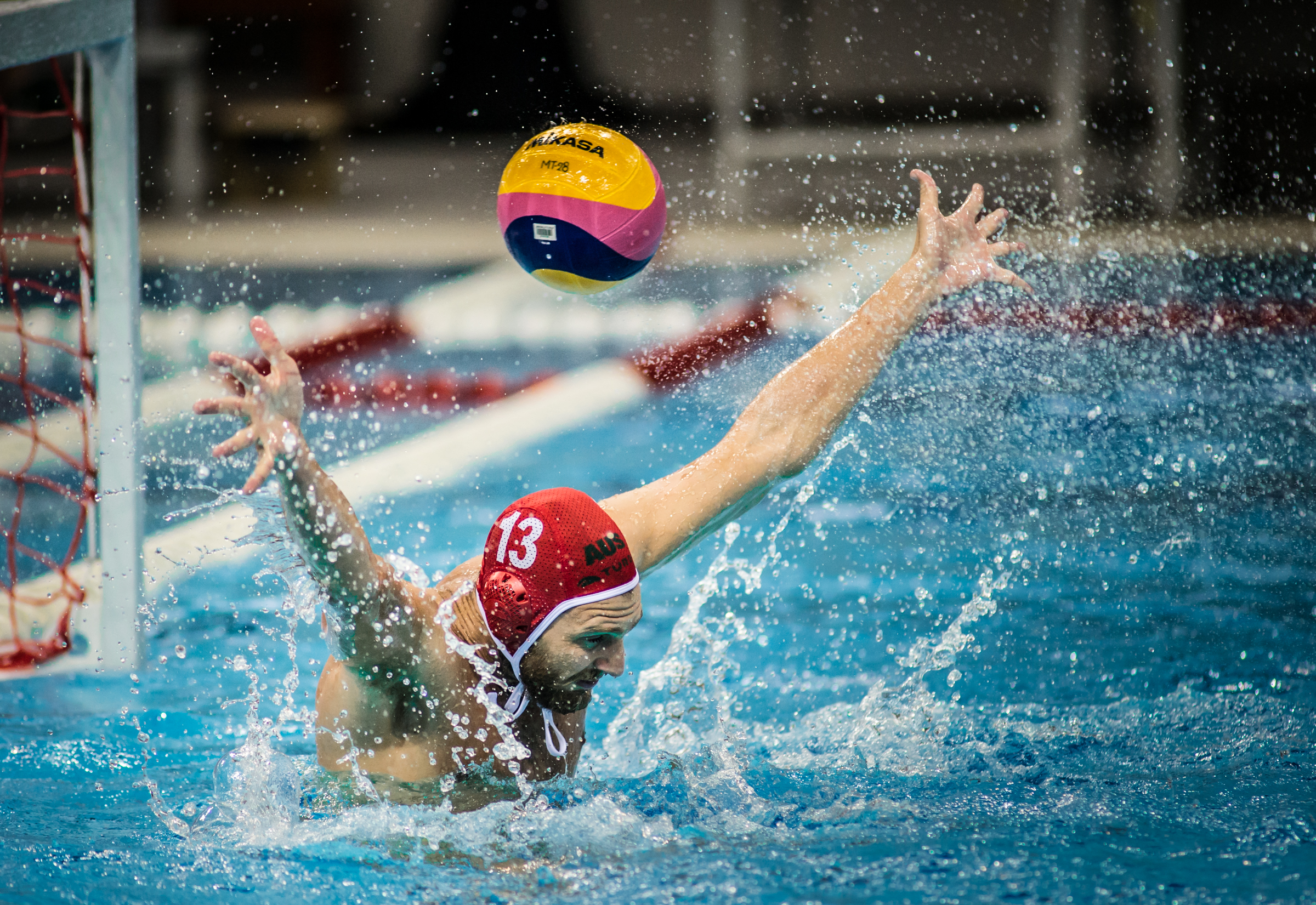 An Australian goal keeper attempts to block the ball during the Greece vs Australia pre-Olympic sparring match at the OCBC Aquatic Centre.