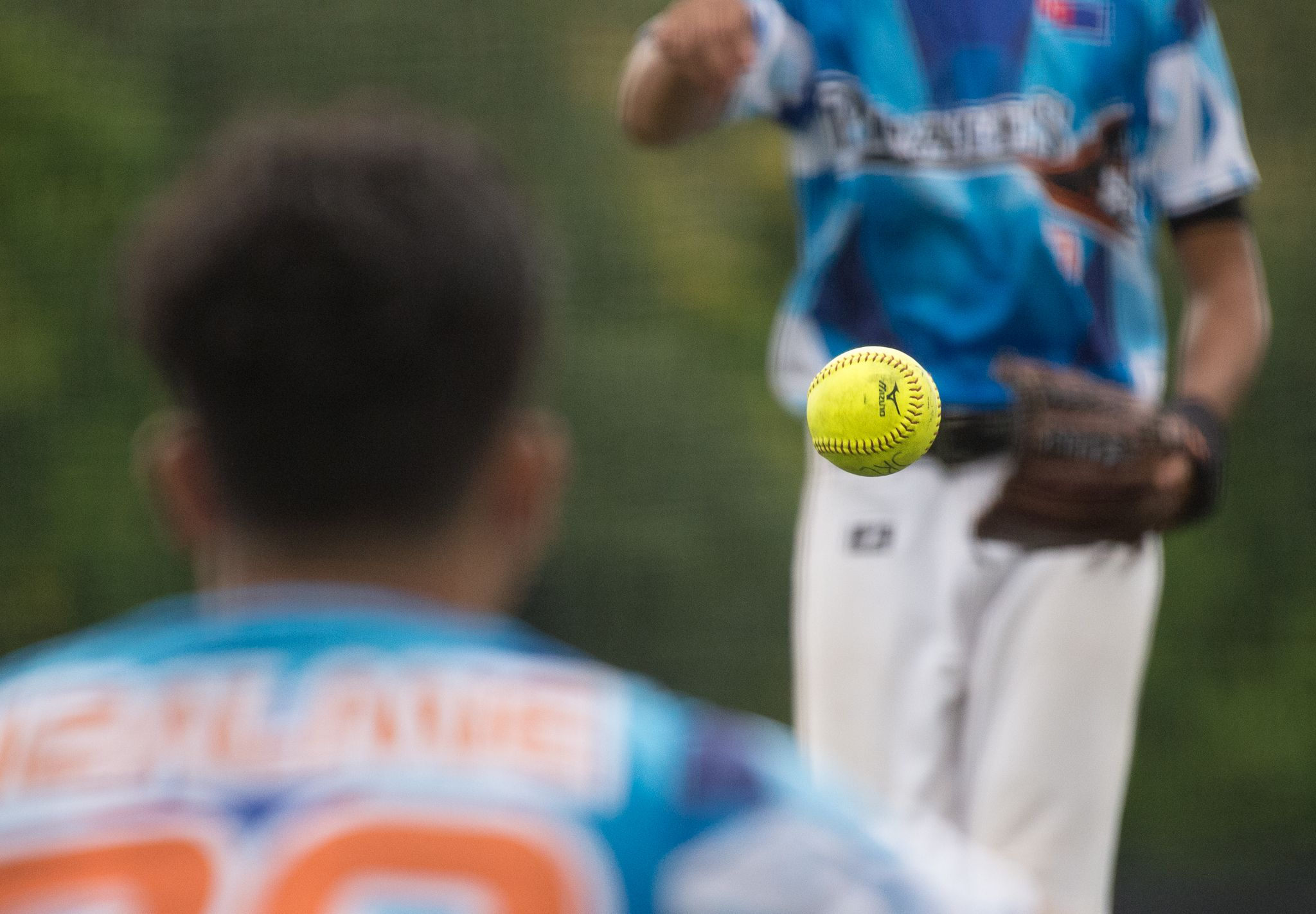 A Malaysian player watches the the ball during the ORA Gryphon Cup slow pitch tournament at Raffles Institution.