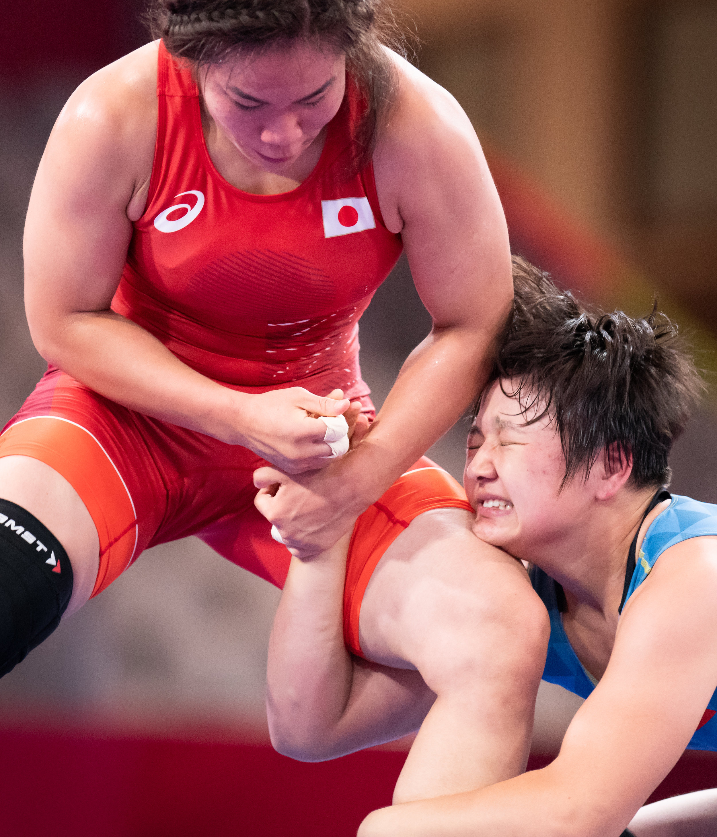 Japanese and Kyrgyz wrestlers in action during the women's freestyle 68kg bronze medal match of the Asian Games at the Jakarta Convention Centre.