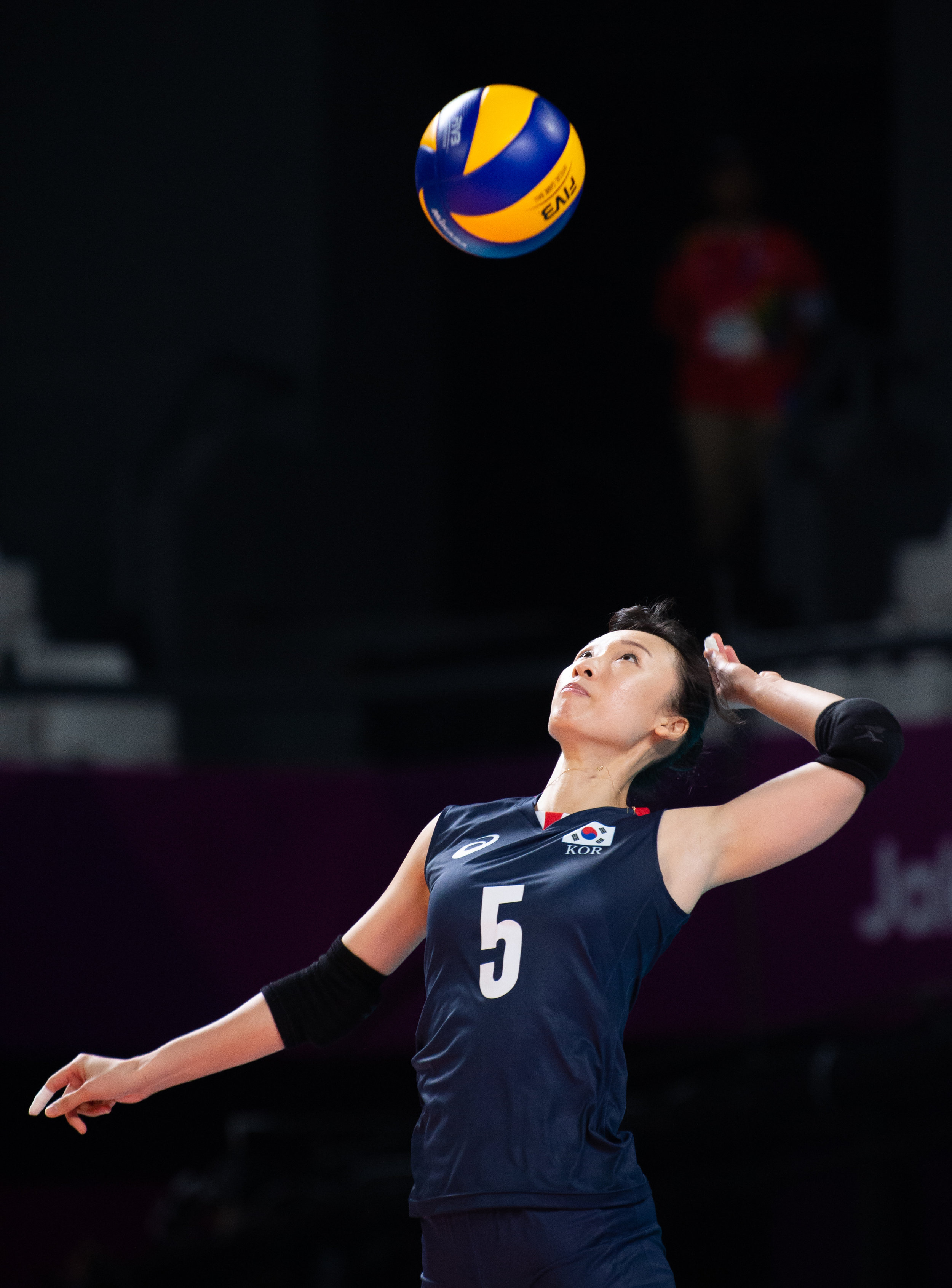 A Korean player serves during the Women's Volleyball match against Vietnam of the Asian Games at the Gelora Bung Karno Sports Complex.