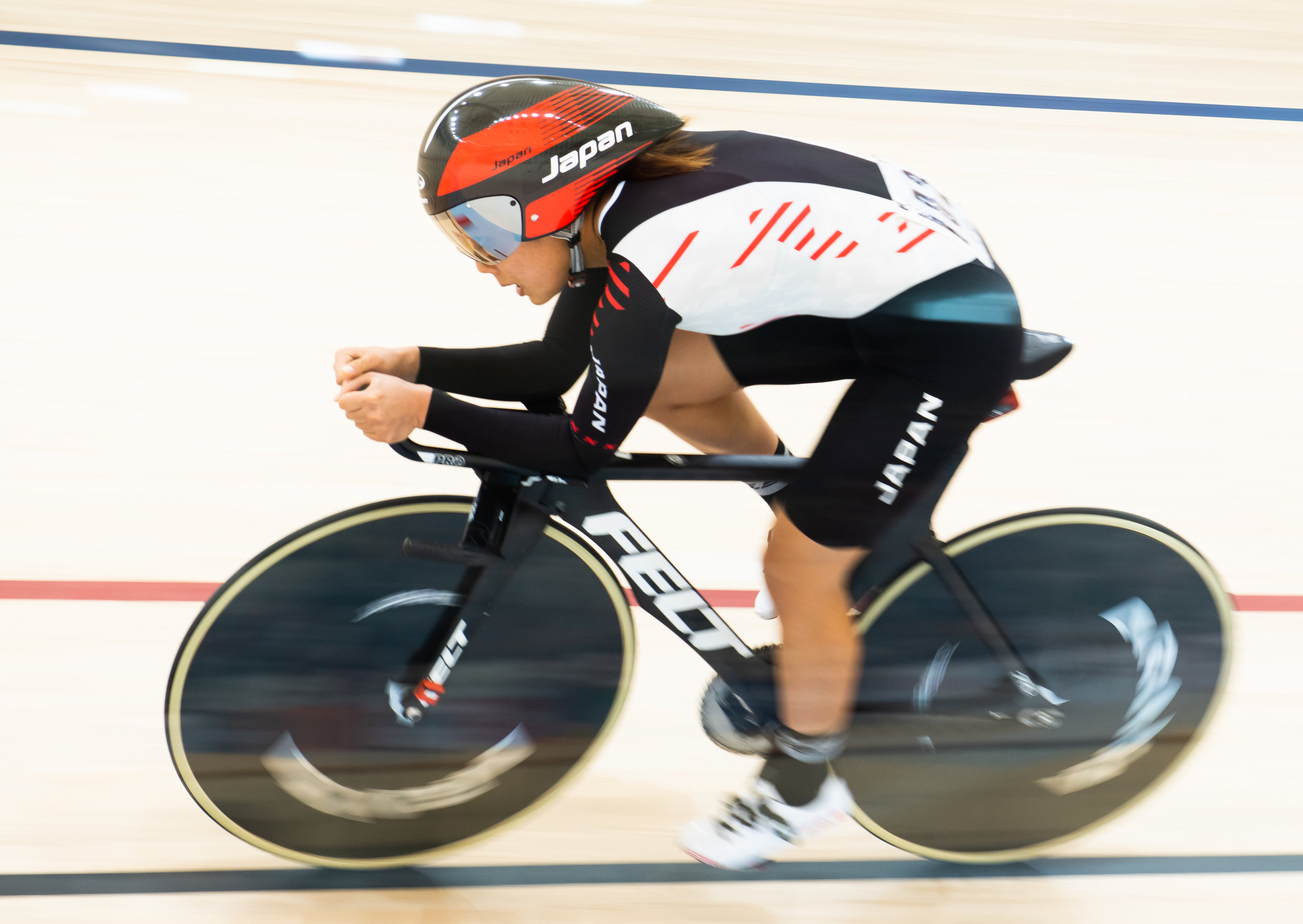 A Japanese cyclist during the Asian Games at the Jakarta Velodrome.