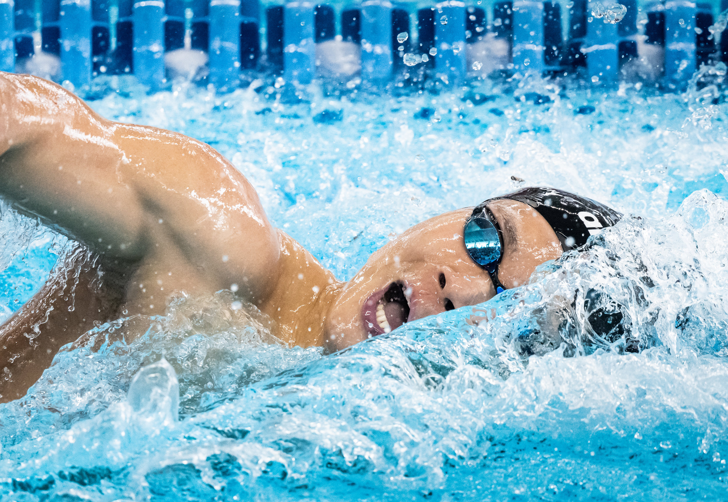 A Singaporean swimmer during the 400m Individual Medley Relay of the Asian Games at the GBK Aquatic Centre.