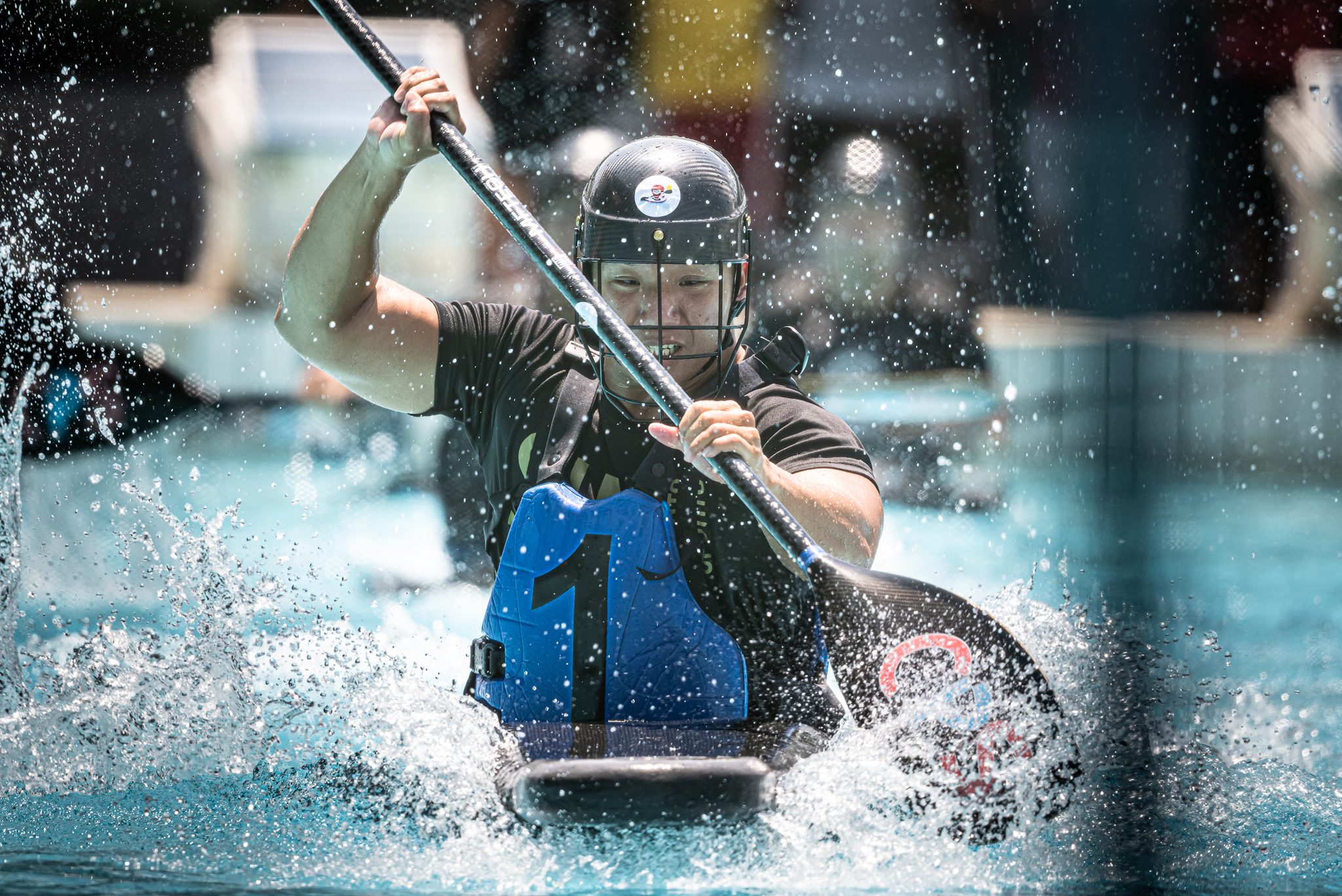A Canoe polo player in action during the Pesta Sukan Canoe Polo Championships at Toa Payoh Swimming Complex.