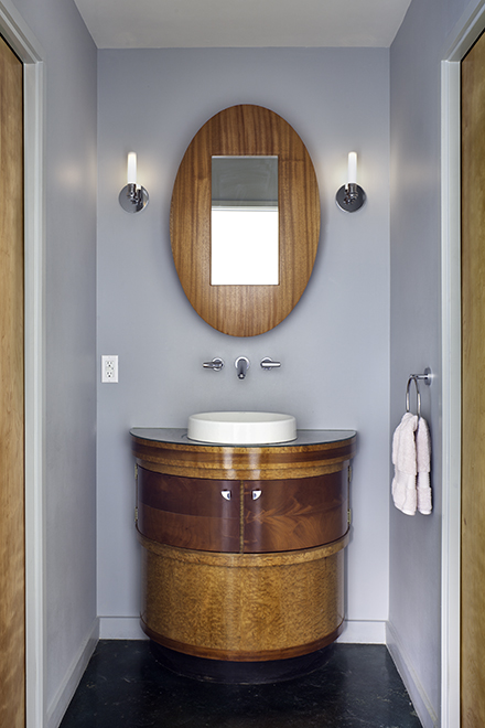 Bathroom lavatory. Repurposed vintage Art Deco stand; mirror cabinet by Peter Zubiate. Devine Street Residence, San Antonio, Texas, 2009. Photo by Chris Cooper Photography