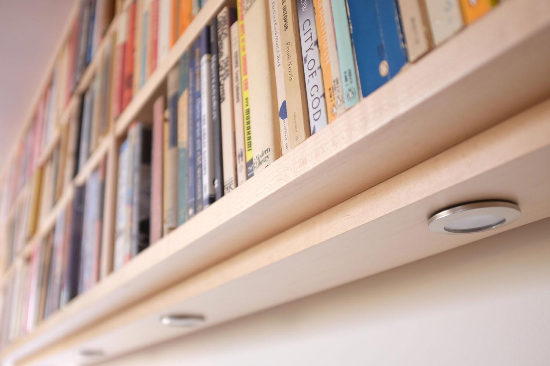 Halogen lights underneath the shelves