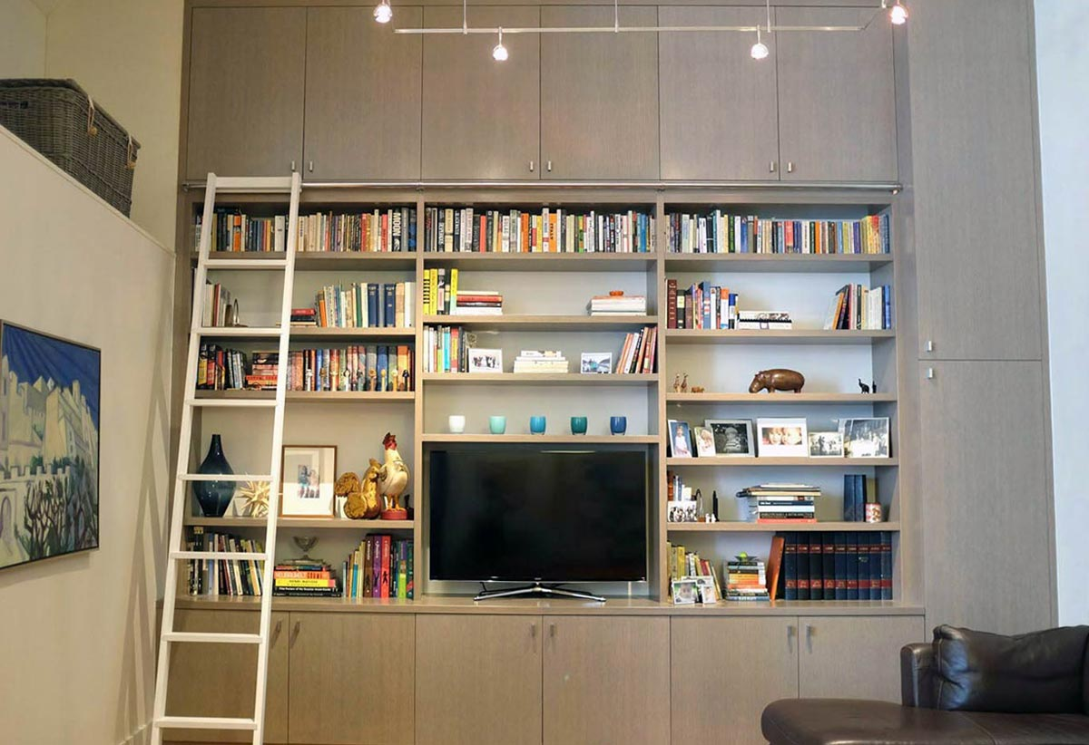 Media cabinets and shelves with plenty of storage, in grey-washed rift white oak.