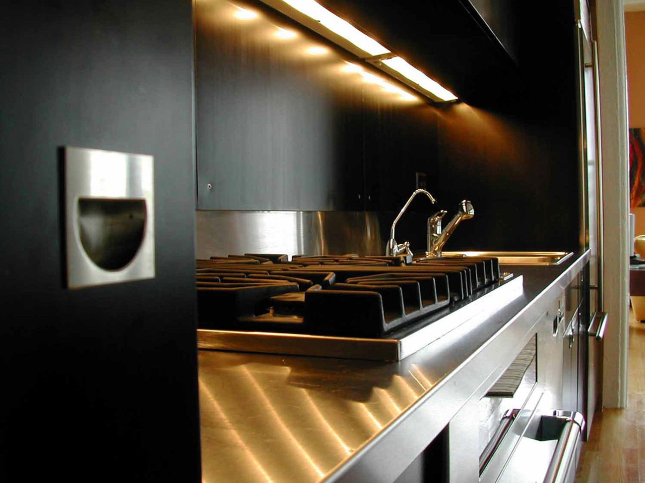 Refaced custom kitchen cabinets with modern black finish