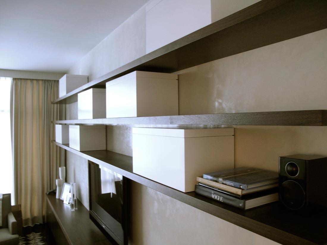 Custom walnut true floating shelves