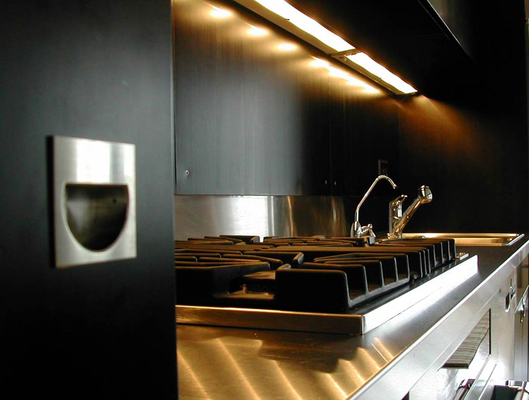 Kitchen cabinets with a modern black finish.