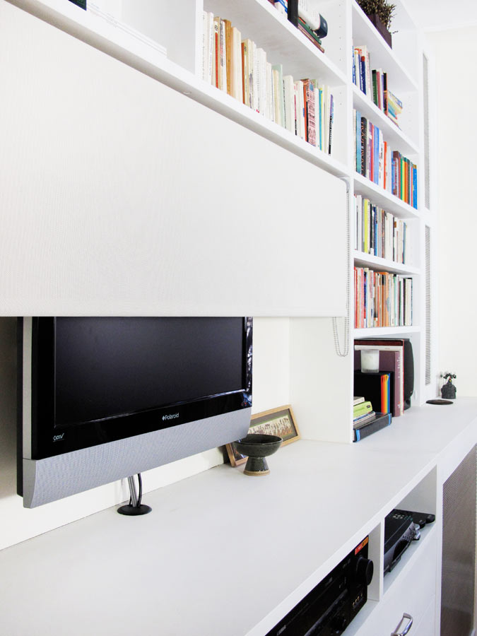 A custom-fitted screen hides the TV