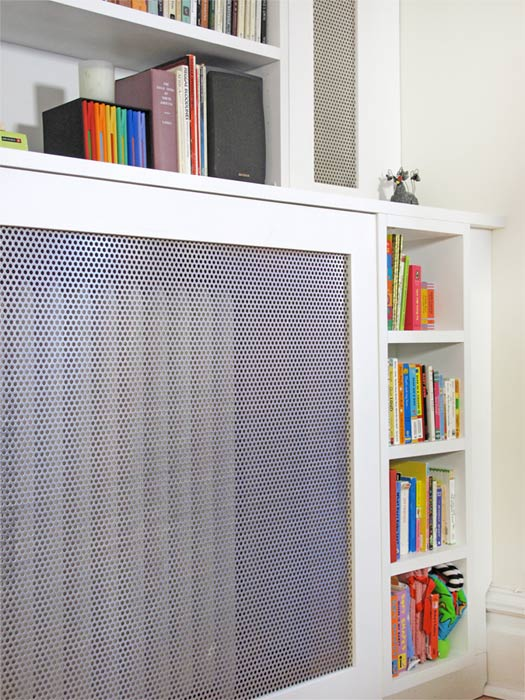 A custom radiator cover seamlessly incorporated into built-ins.
