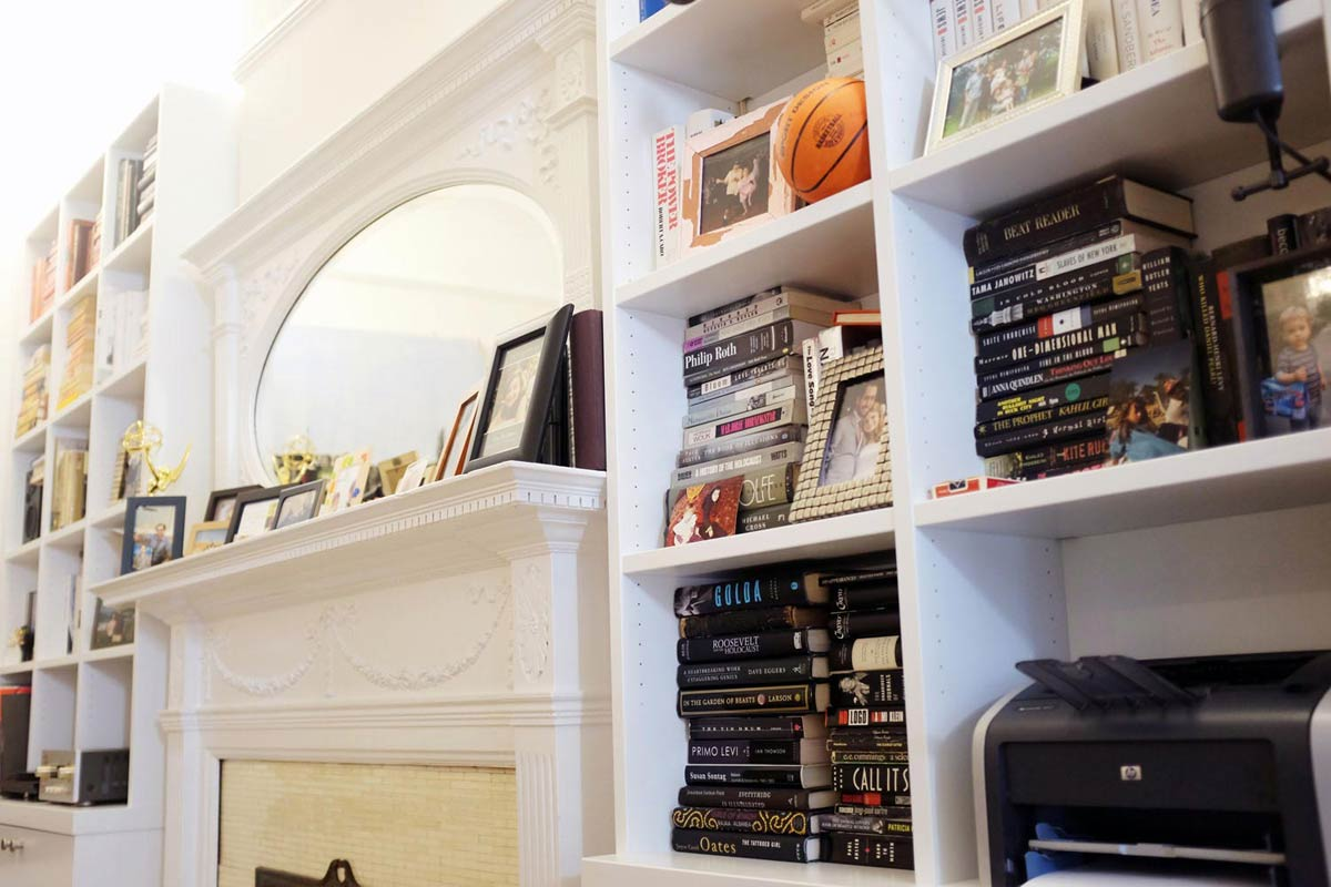These built-in bookshelves have metal supports that fit into tiny slots that allow the shelf heights to be adjusted.