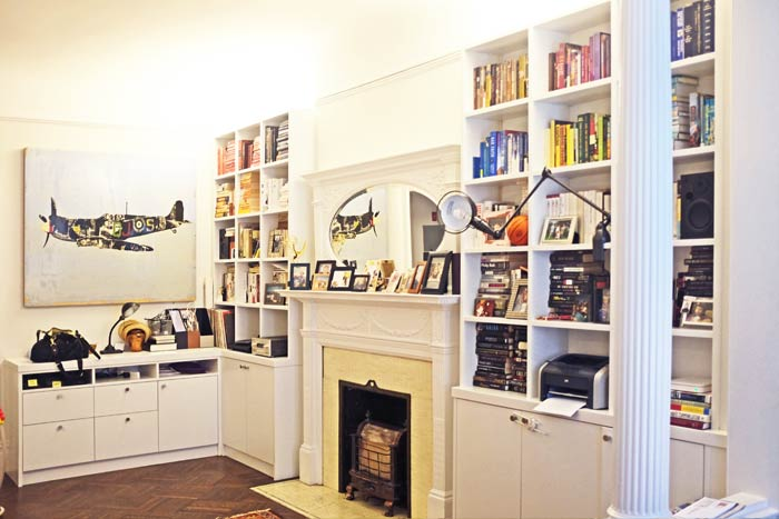 Built-in bookshelves surround the fireplace.