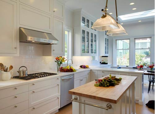 Upper cabinets are inset- Photo by Mahoney Architects & Interiors
