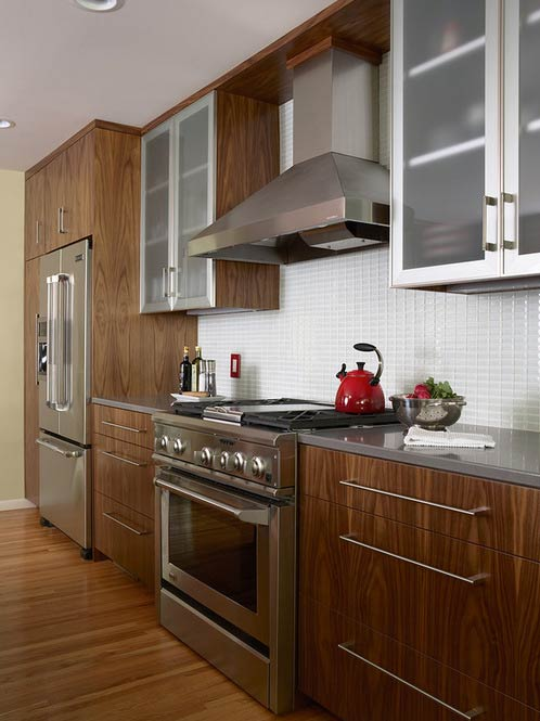 The upper cabinets have aluminum doors-Photo by Indicia Interior Design
