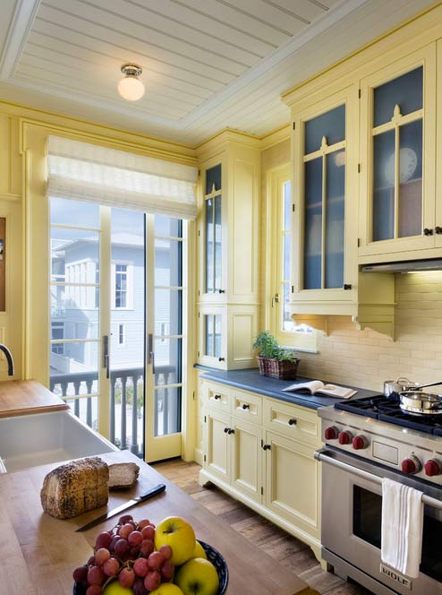 Custom yellow kitchen cabinets with mullion glass doors- Photo by Gary Brewer Robert A.M. Stern Architects