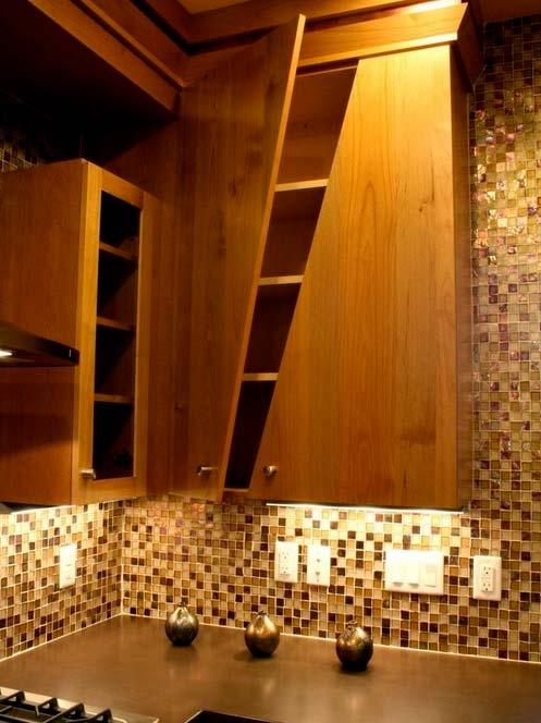 Custom asymmetrical cabinets- Photo by Aneka Interiors Inc.