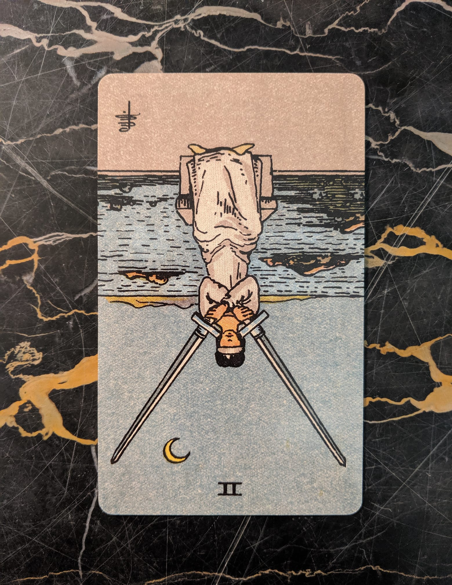 This card is from the Rider-Waite deck, published in 1909, borderless edition