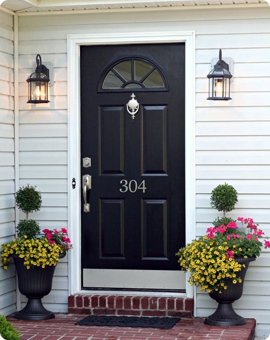 Updating your hardware and light fixtures can give your front door a new look. Symmetry also helps create a welcoming entryway.