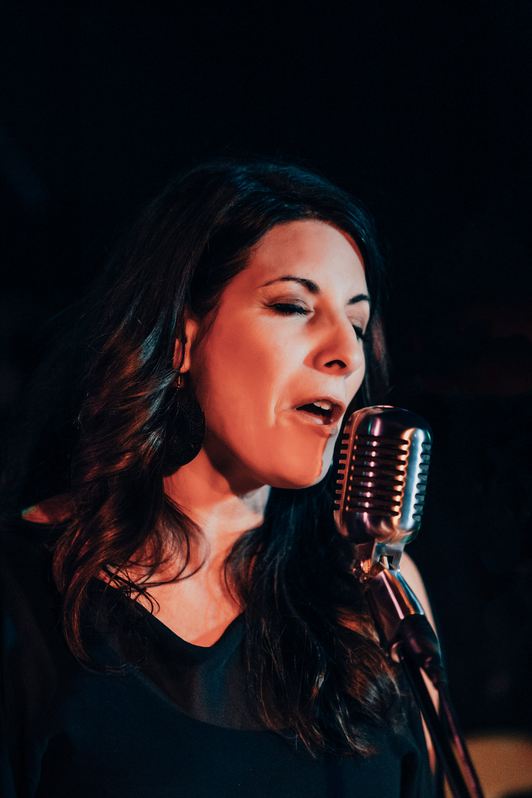 close up of female vocalist performing on stage