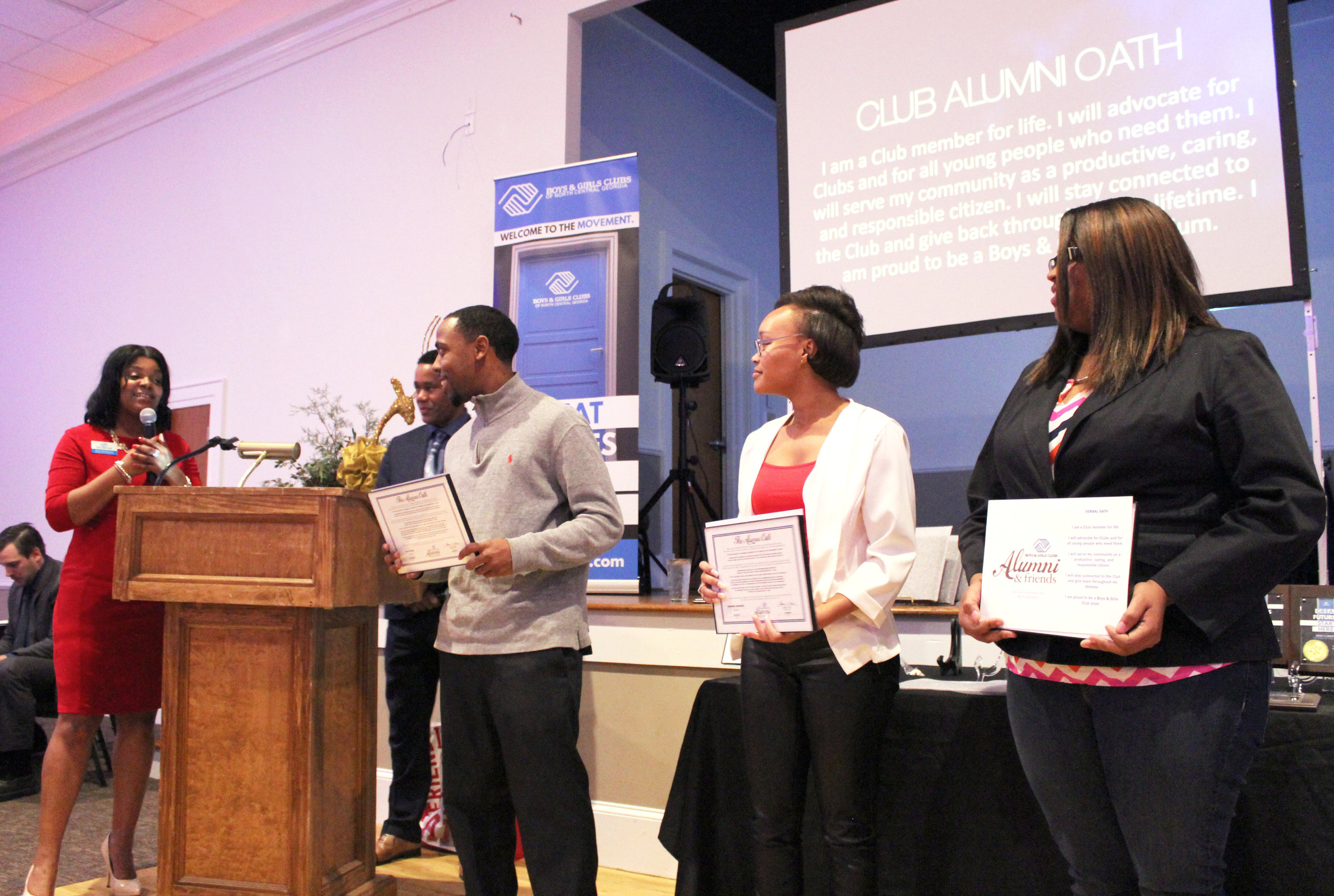 Karen Robertson leads Tay Hyman (MMBGC), Diondra Burgess (PNBGC) and Chastity Morrissette (WCBGC) in the alumni oath.