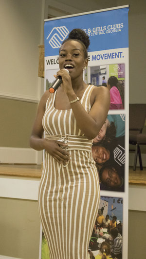 "Bria Anai, BGCNCG Club alum, sang Whitney Houston's ""When You Believe"" prior to Liz Huntley speaking."