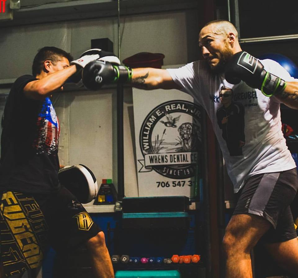 """Glory Kickboxing  fighter,  Richard """"maximus"""" Abraham  getting some mitt work in with  coach greubel!"""