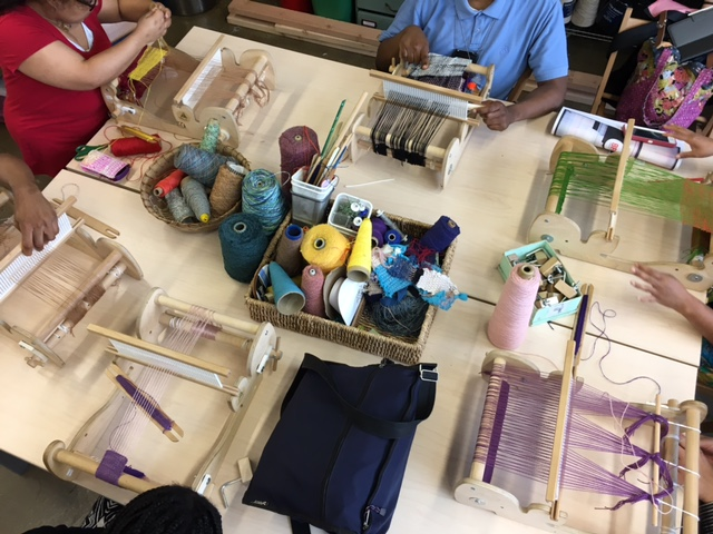 STUDENTS WEAVING