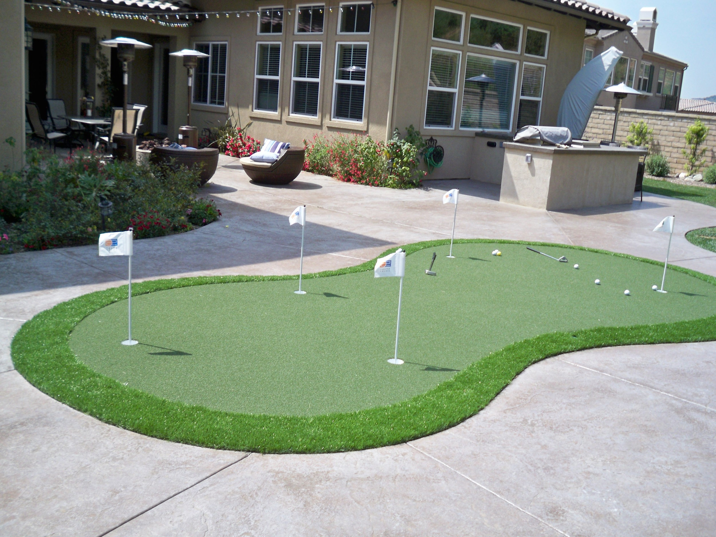 Synthetic grass by pavers