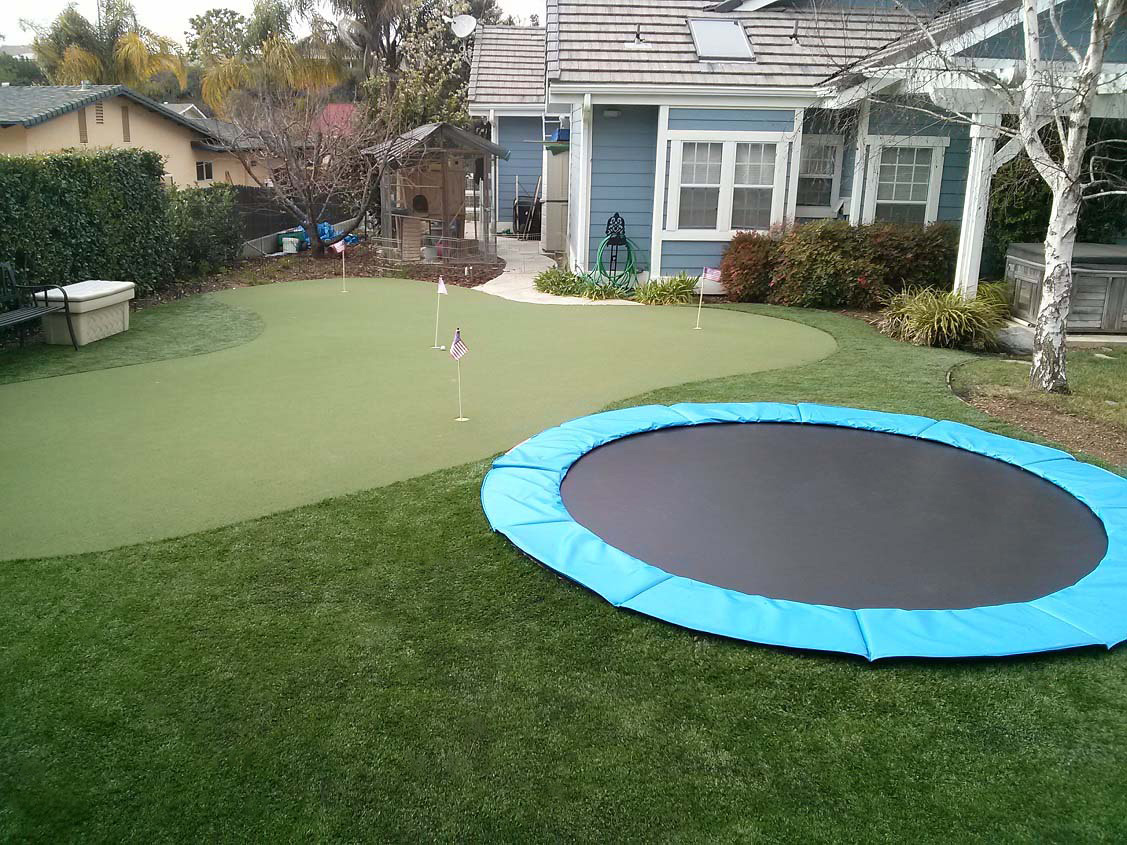 In ground trampoline with synthetic grass