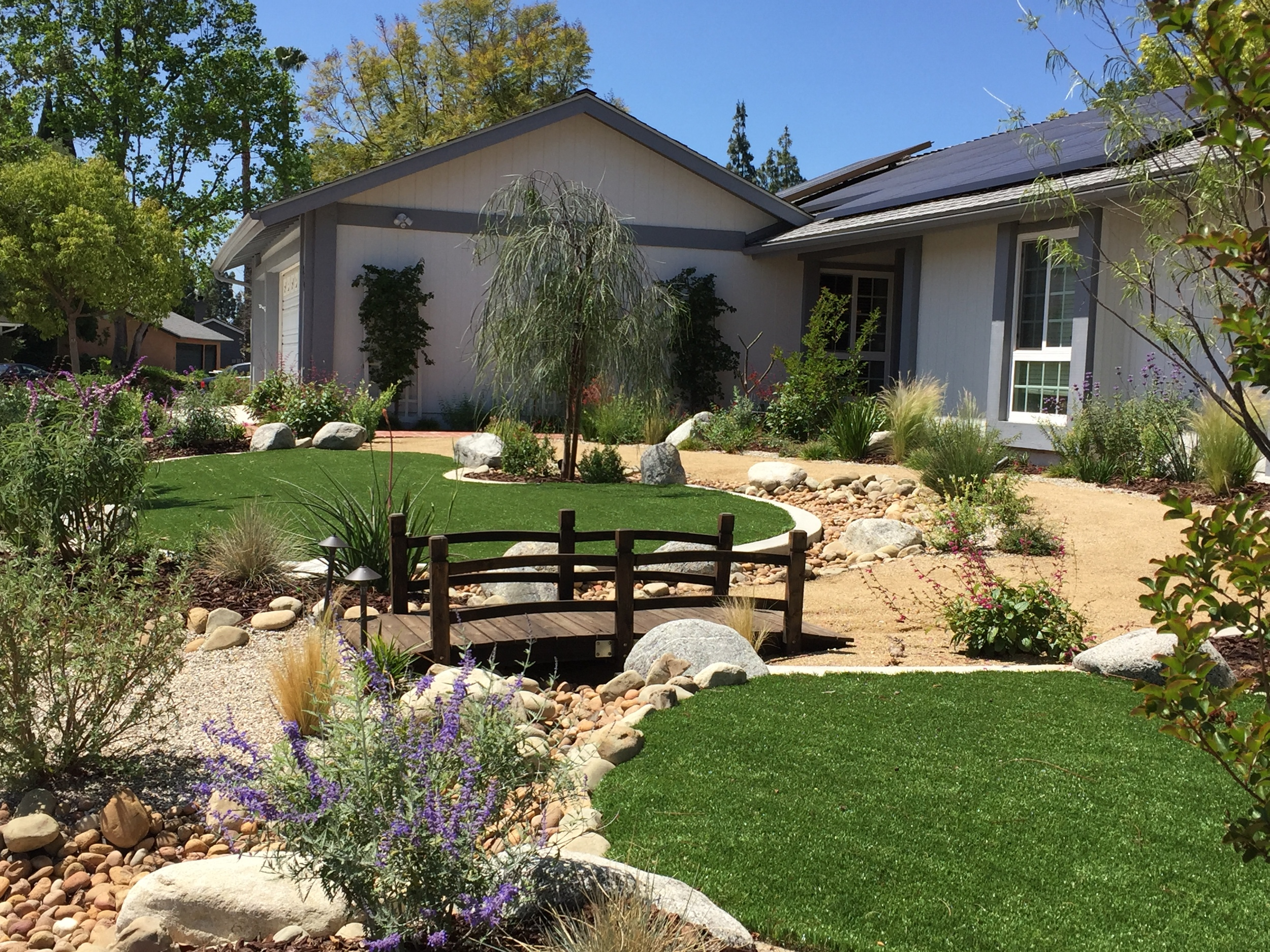 Drought tolerant landscape with synthetic grass