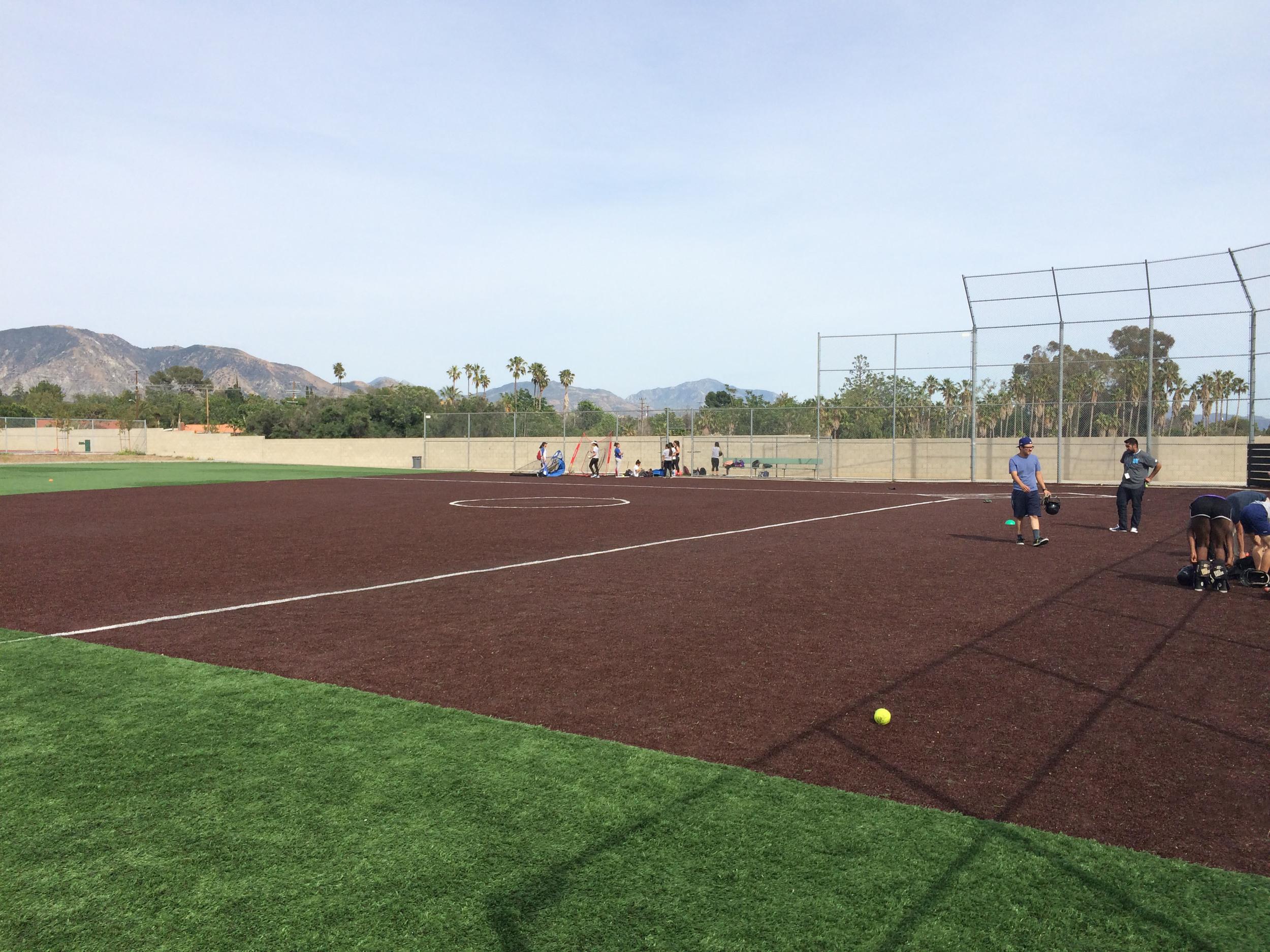 Synthetic artificial grass baseball field