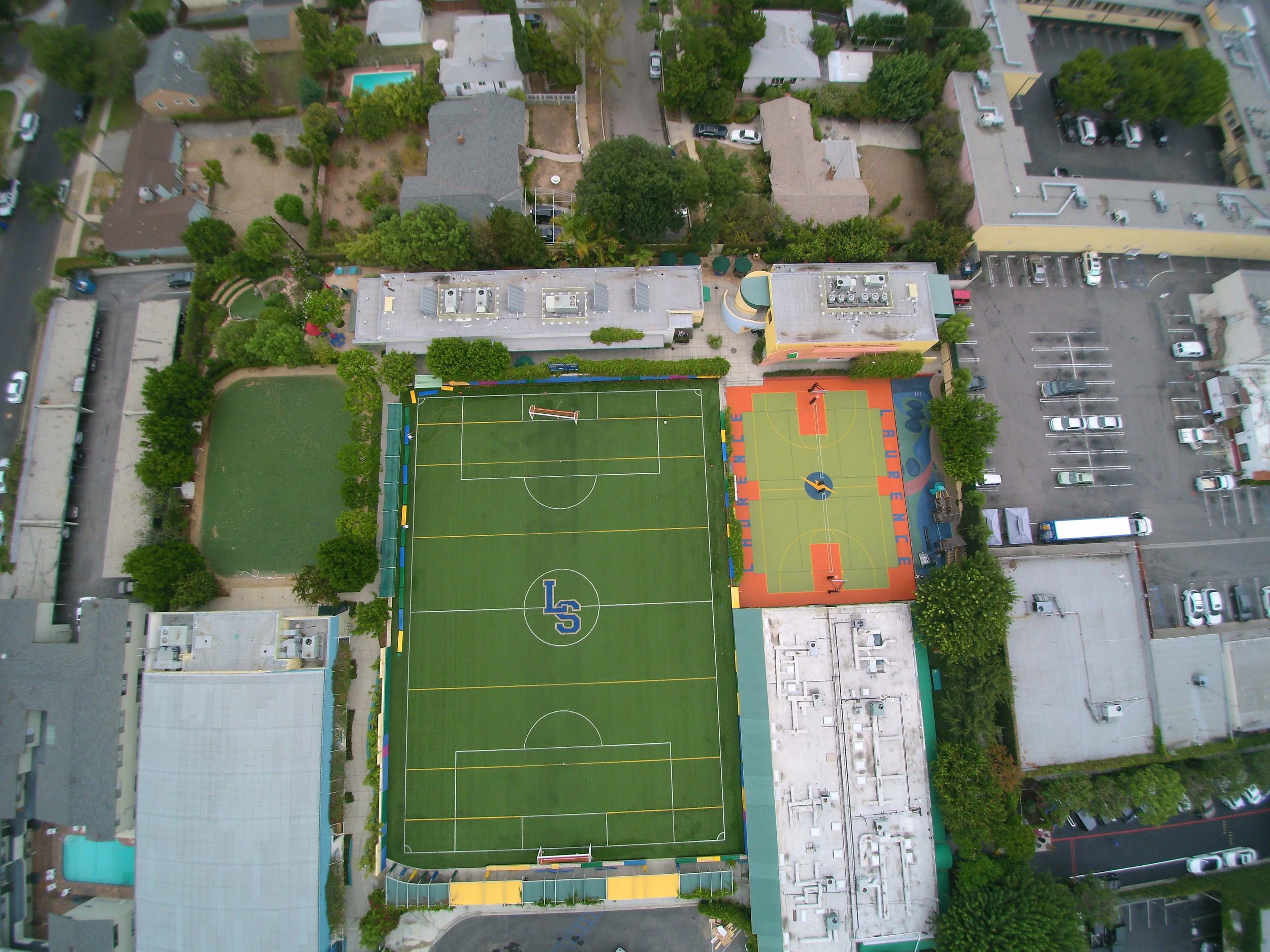 Synthetic grass by sport court