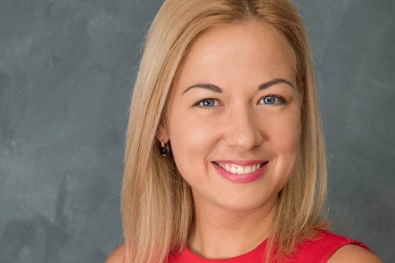 Executive head shot -smiling young woman