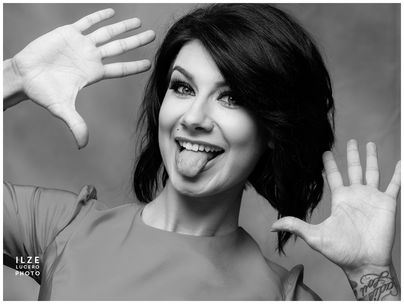 Goofy fun outtake from a fun photo session -  black and white photo of a beautiful woman