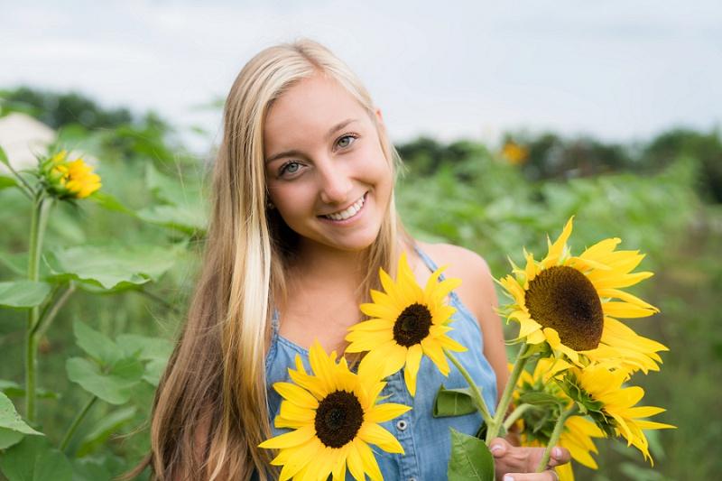 Senior photo shoot  - sunflower fields in Michigan